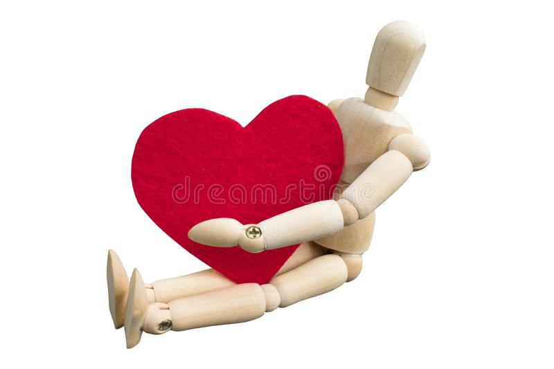 Concetto di giorno del ` s del biglietto di S Abbraccio fittizio di legno una forma del cuore che ha fatto da tessuto ritenuto ac immagine stock