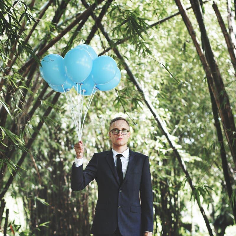 Concetto di Holding Balloons Nature dell'uomo d'affari fotografia stock libera da diritti