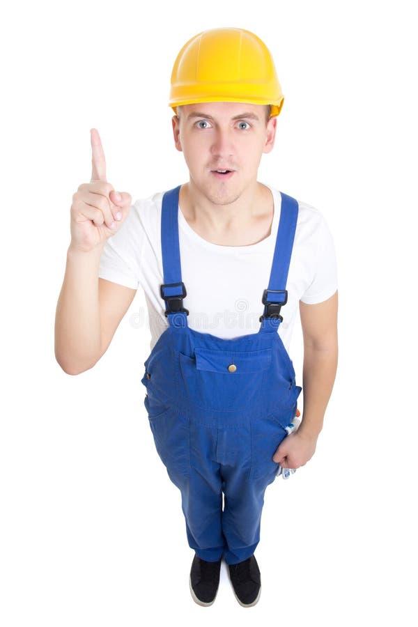 Concetto di idea - costruttore divertente dell'uomo in uniforme del blu isolata sul whi fotografia stock libera da diritti