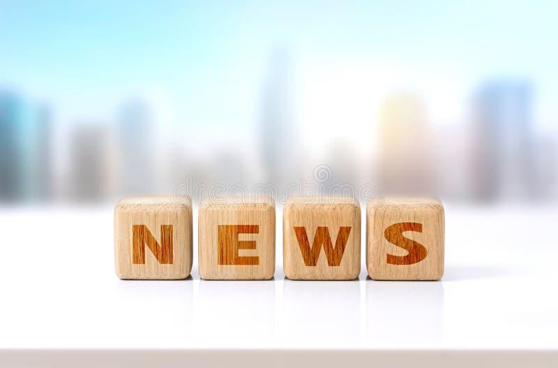 Concetto di legno di notizie di parola dei cubi immagine stock
