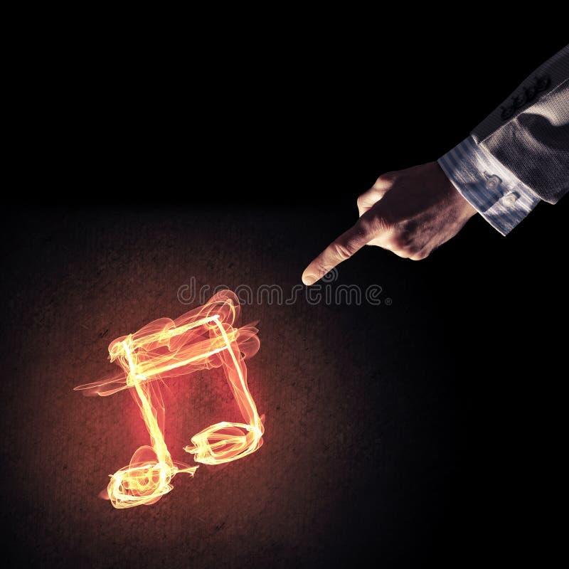 Concetto di musica presentato dall'icona bruciante del fuoco fotografia stock