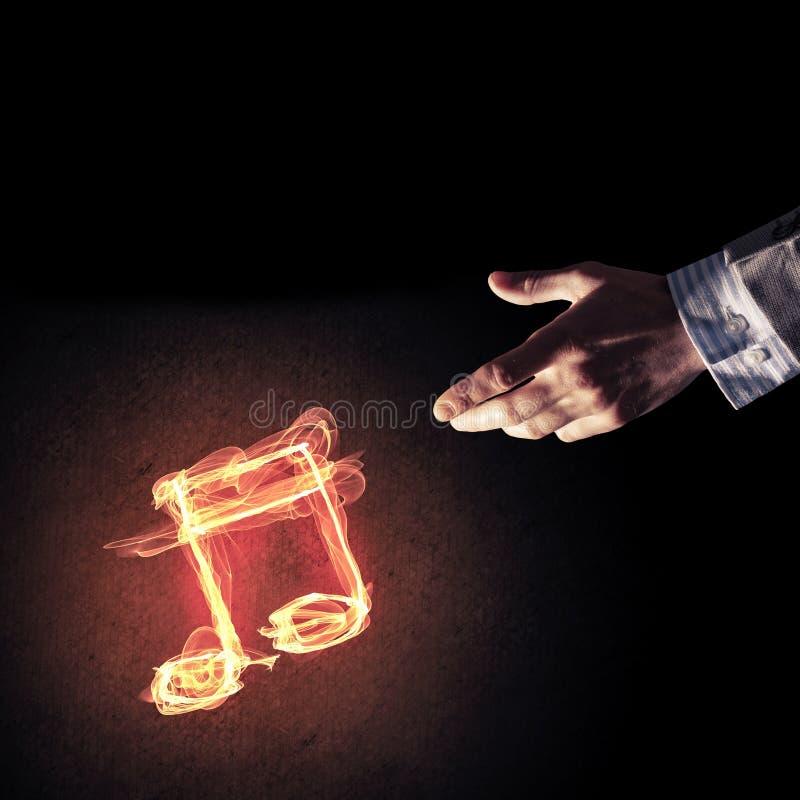 Concetto di musica presentato dall'icona bruciante del fuoco immagine stock