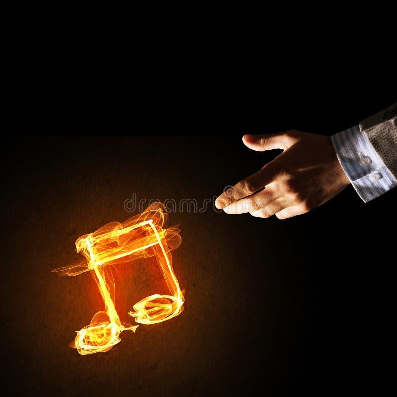 Concetto di musica presentato dall'icona bruciante del fuoco immagini stock