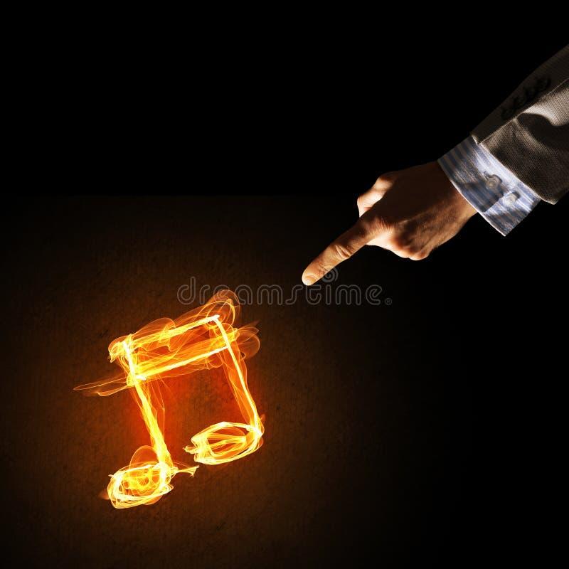 Concetto di musica presentato dall'icona bruciante del fuoco immagini stock libere da diritti