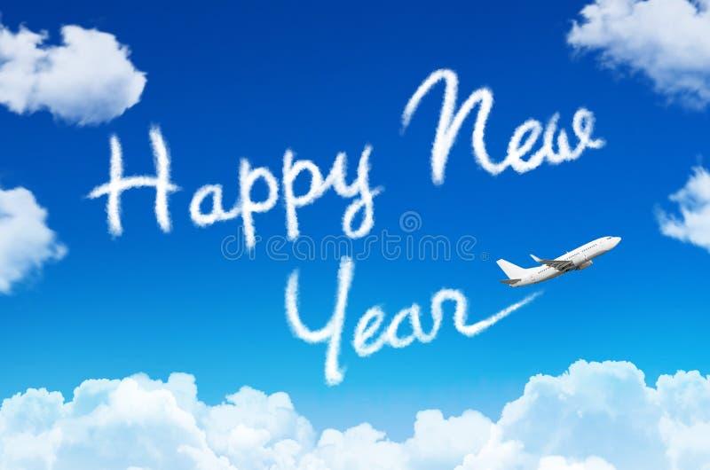 Concetto di nuovo anno felice Disegnando dalla scia del vapore dell'aeroplano in cielo fotografie stock libere da diritti