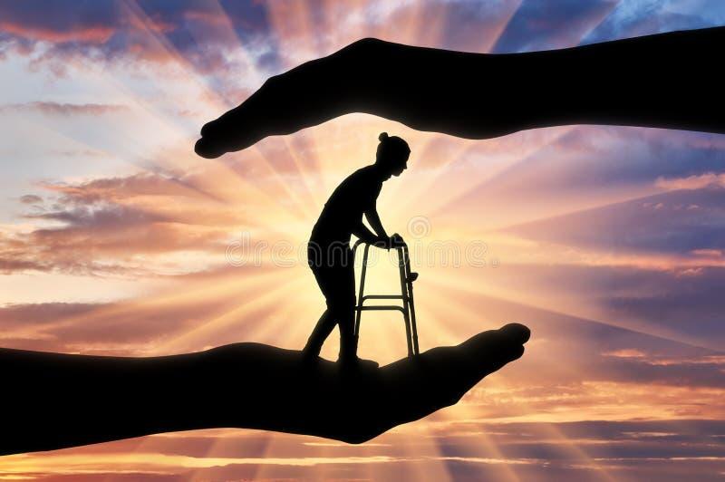 Concetto di protezione e di assistenza al disabile ed agli anziani immagini stock libere da diritti
