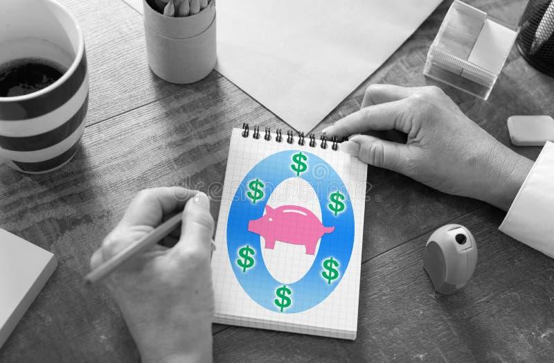 Concetto di risparmio dei soldi su un blocco note fotografia stock libera da diritti
