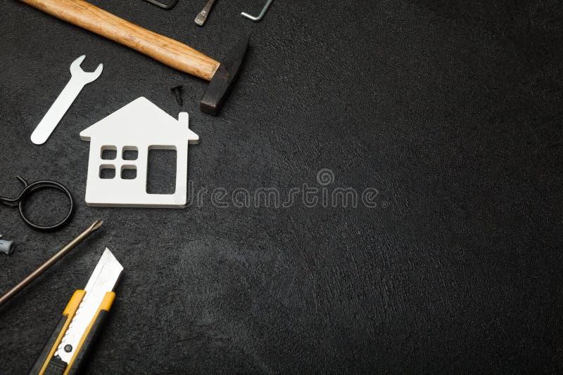 Concetto domestico della costruzione, calcolatore di costo fotografia stock libera da diritti