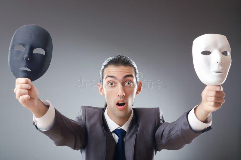 Concetto industriale del espionate - uomo d'affari mascherato immagini stock