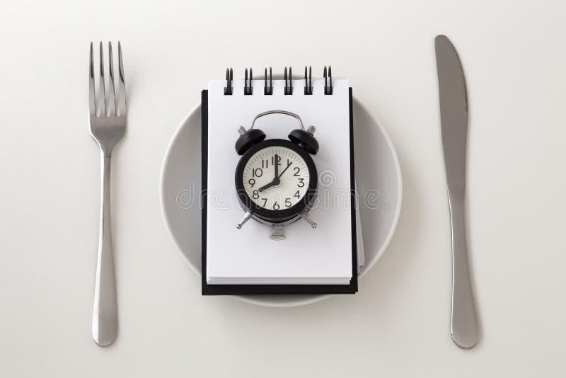 Concetto intermittente di piano del pasto e di digiuno immagine stock