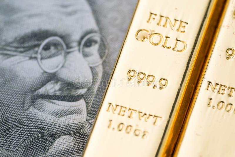 Concetto nazionale della riserva aurea dell'India, lingotto brillante Ingo della barra di oro immagini stock libere da diritti