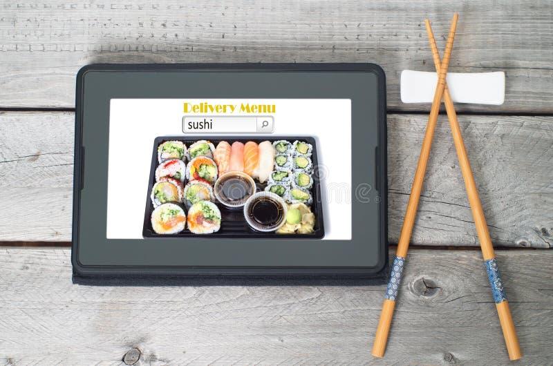 Concetto online del menu di consegna dei sushi fotografia stock