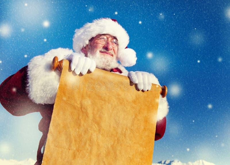 Concetto tradizionale di Santa Claus Paper Scroll Christmas Sign immagini stock libere da diritti