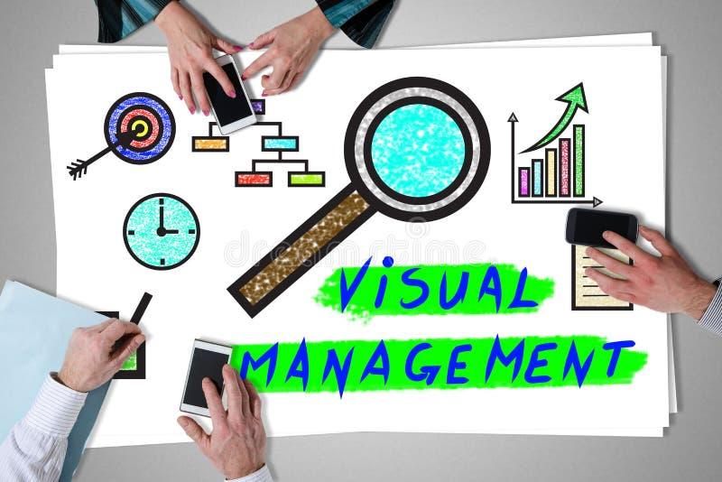 Concetto visivo della gestione disposto su uno scrittorio fotografia stock libera da diritti