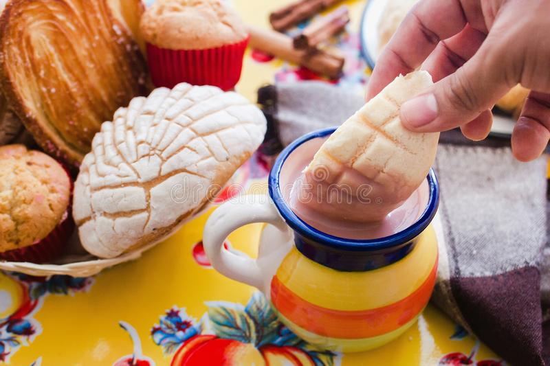 Concha and chocolate, mexican sweet bread and atole beverage in mexico breakfast. Concha bread and chocolate, mexican sweet bread and atole beverage in mexico stock photo