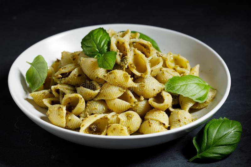 Conchiglie pasta with pesto sauce royalty free stock photography