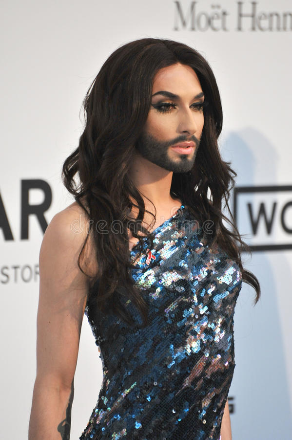 Conchita Wurst. ANTIBES, FRANCE - MAY 22, 2014: Eurovision Song Contest winner Conchita Wurst at the 21st annual amfAR Cinema Against AIDS Gala at the Hotel du royalty free stock images