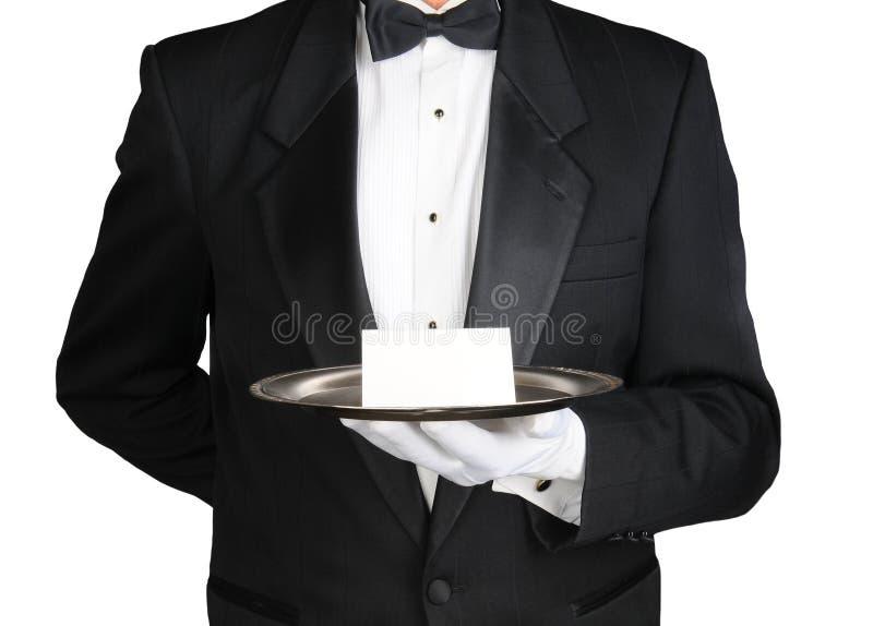 Concierge avec la note sur le plateau photos stock