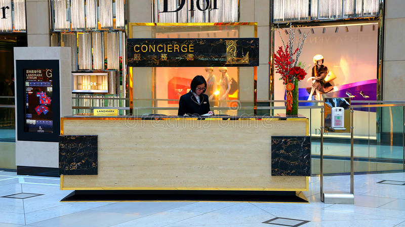 Concierge desk. Female clerk at the concierge desk at landmark shopping mall in hong kong stock photography