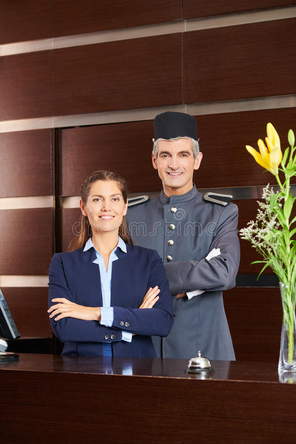 Concierge and receptionist at hotel reception. Concierge and receptionist as team at hotel reception stock photo