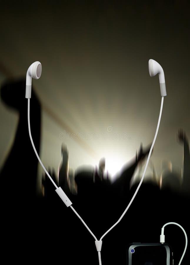 Concierto musical con los auriculares imagen de archivo libre de regalías