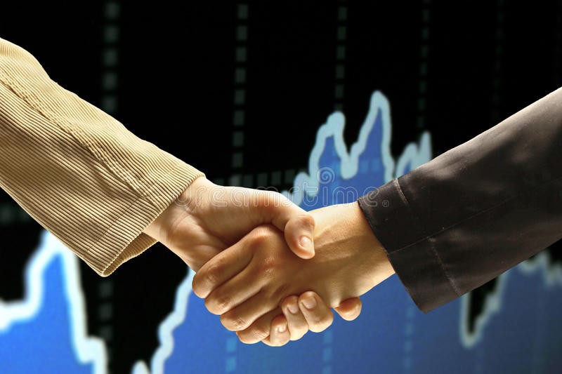 The conclusion of the transaction. Handshake stock image