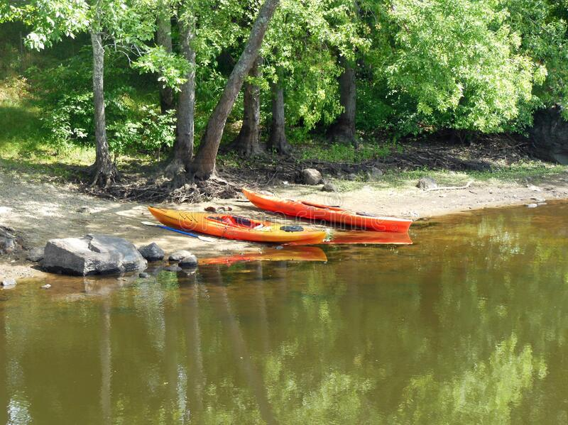 Kayaking Boats by Concord River in Massachusetts royalty free stock photography