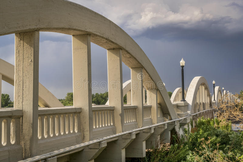 Concrete arch bridge over South Platte River. Rainbow arch bridge over South Platte River in Fort Morgan, Colorado royalty free stock images