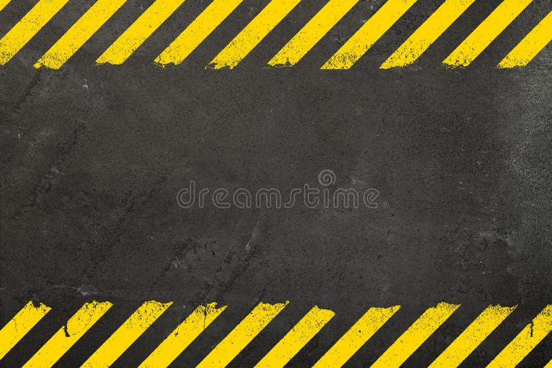 Concrete background with grunge hazard sign royalty free stock photo