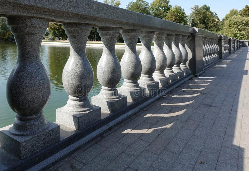 Concrete balustrade with classical pillars standing in a row. Beautiful detail of an old fence royalty free stock photos