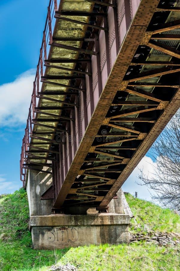 The concrete base iron railway bridge royalty free stock image