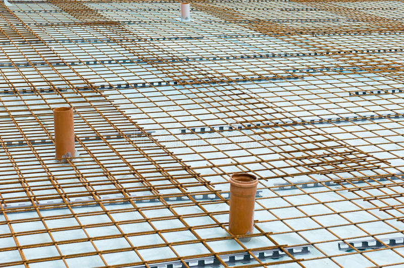 Concrete baseplate. With lock-woven-mesh on a building site royalty free stock photography
