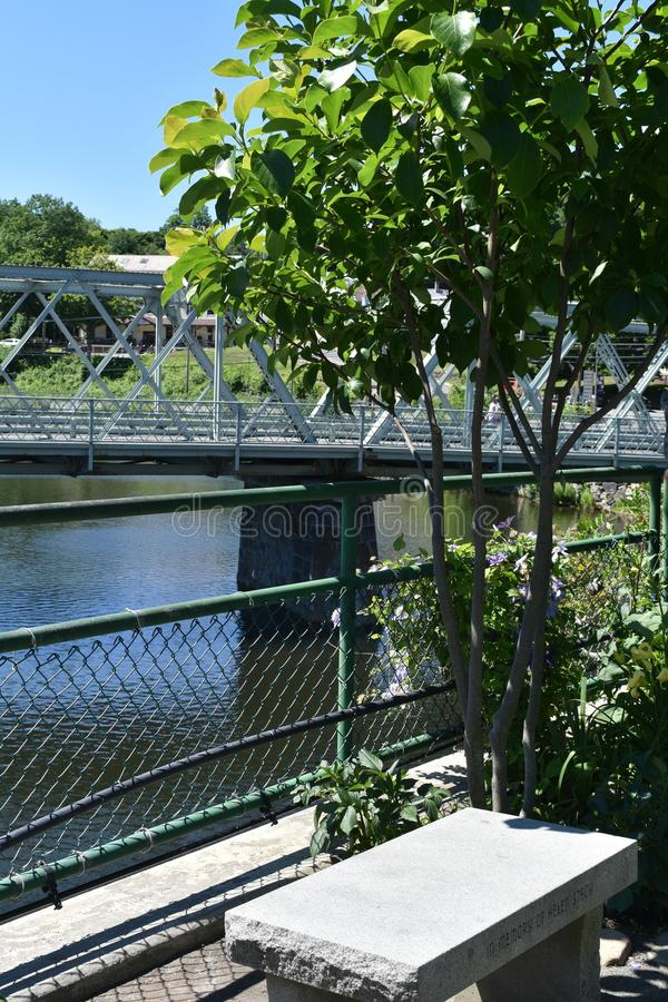 Concrete bench on Bridge of Flowers, Shelburne Falls, Franklin County, Massacusetts, United States, USA royalty free stock image