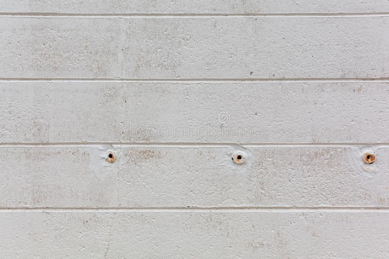 Concrete block walls with weep holes. Rows of painted concrete blocks with weep holes in the early morning light royalty free stock photography