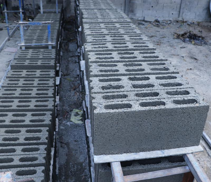 Concrete blocks stacking on the floor. Ready to be collected for construction work royalty free stock image