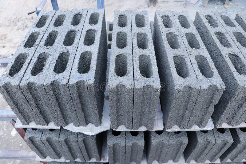 Concrete blocks stacking on the floor. Ready to be collected for construction work stock images