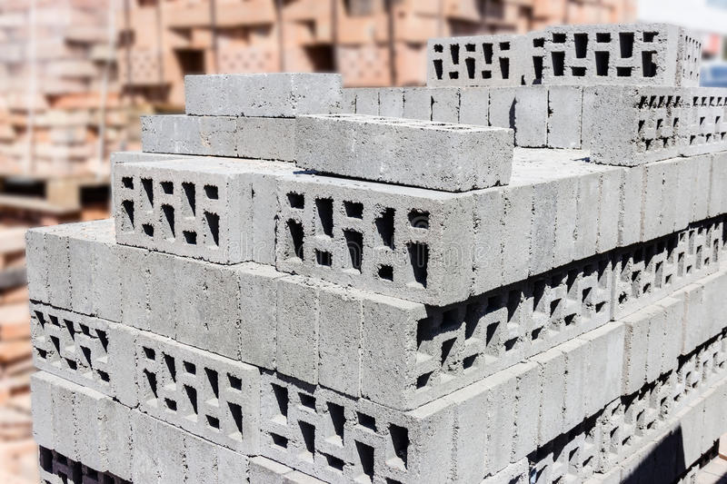 Concrete bricks. Pallet with concrete perforated bricks in warehouse royalty free stock photos