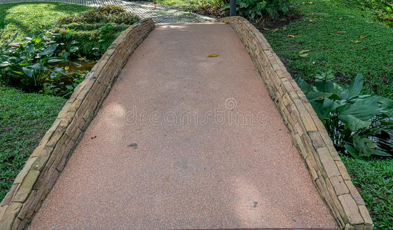 Concrete bridge across the stream stock photography