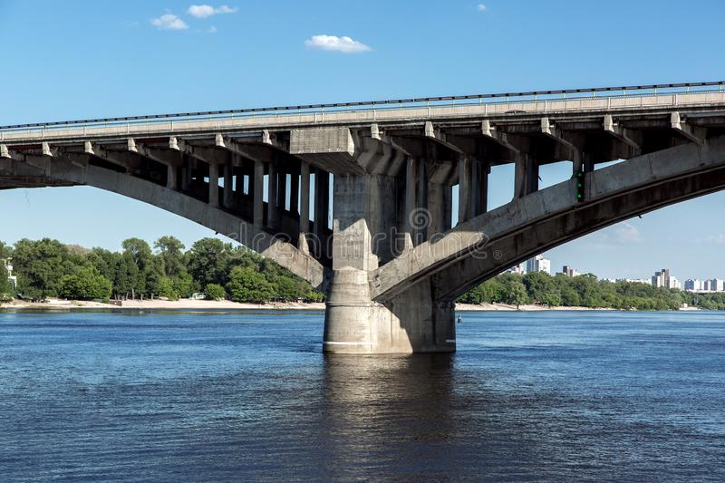 Concrete bridge pillar arch structure. Concrete bridge pillar arch structure in river water, close-up of the support structure and columns stock photography