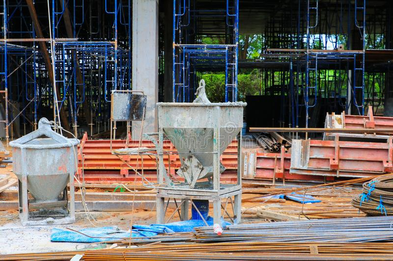 Concrete bucket mixer container cement construction in building. Site workplace royalty free stock photo