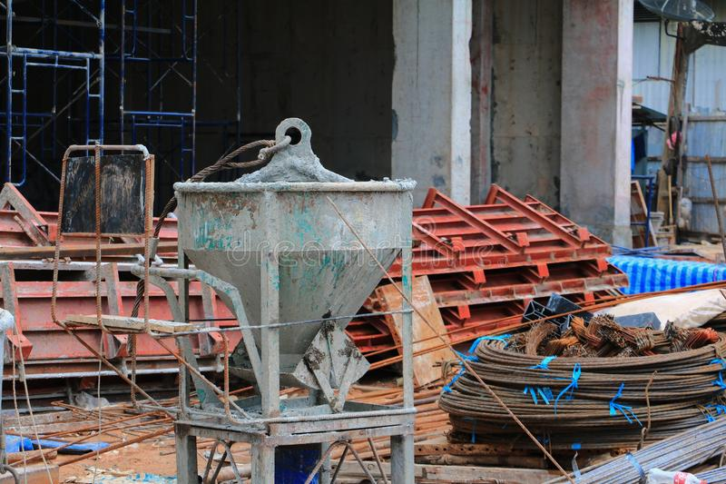 Concrete bucket mixer container cement construction in building. Site workplace royalty free stock image