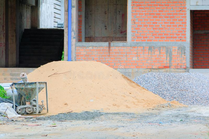 Concrete bucket mixer container cement and sand construction in building site workplace with copy space add text.  stock photography