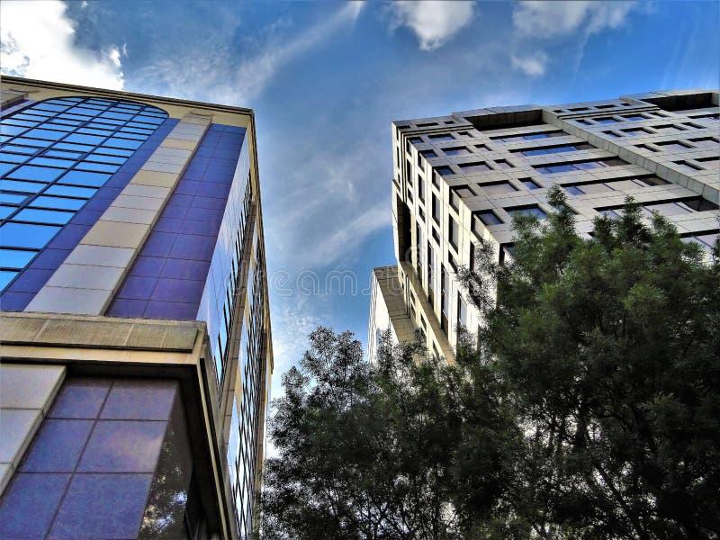 Concrete Building Photo Under Cloudy Sky stock images
