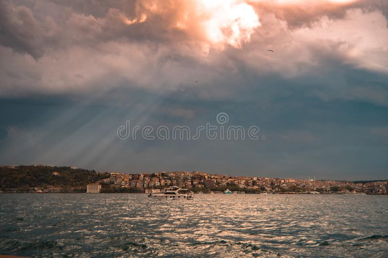 Concrete Buildings Near Sea Under White and Blue Cloudy Sky royalty free stock photo