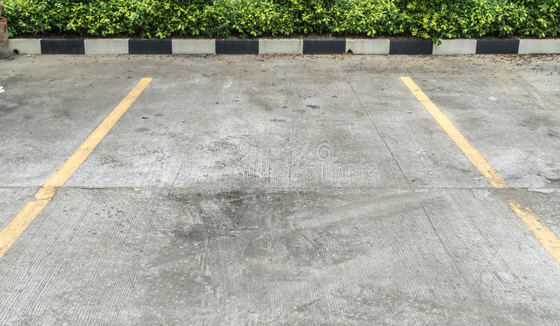Concrete carpark. Yellow line on concrete carpark royalty free stock photos