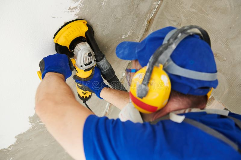 Concrete ceiling surface grinding by angle grinder machine royalty free stock image