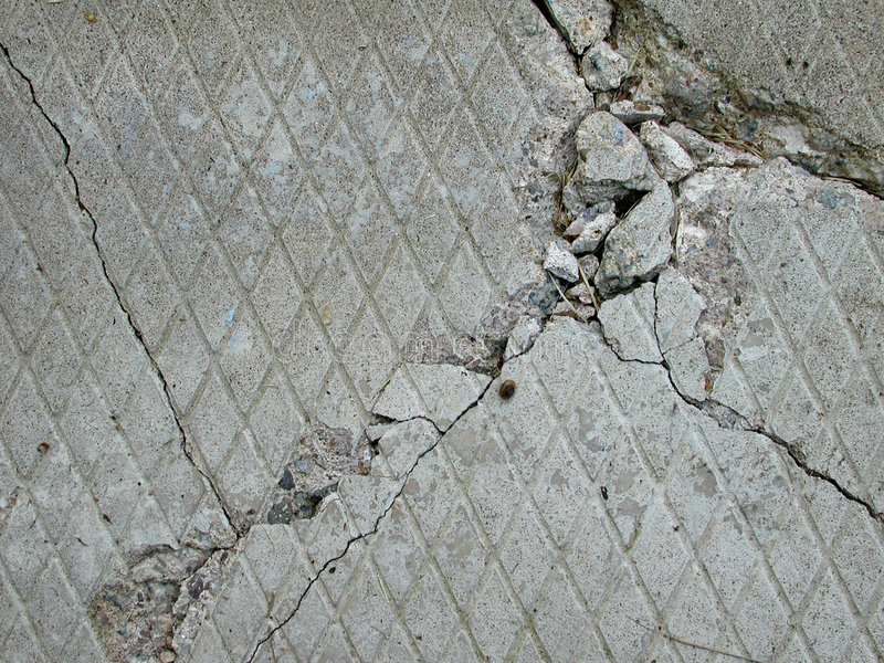 Concrete Cement Brick Texture. A section of cracked brick, stone or rock great as a background or texture stock image