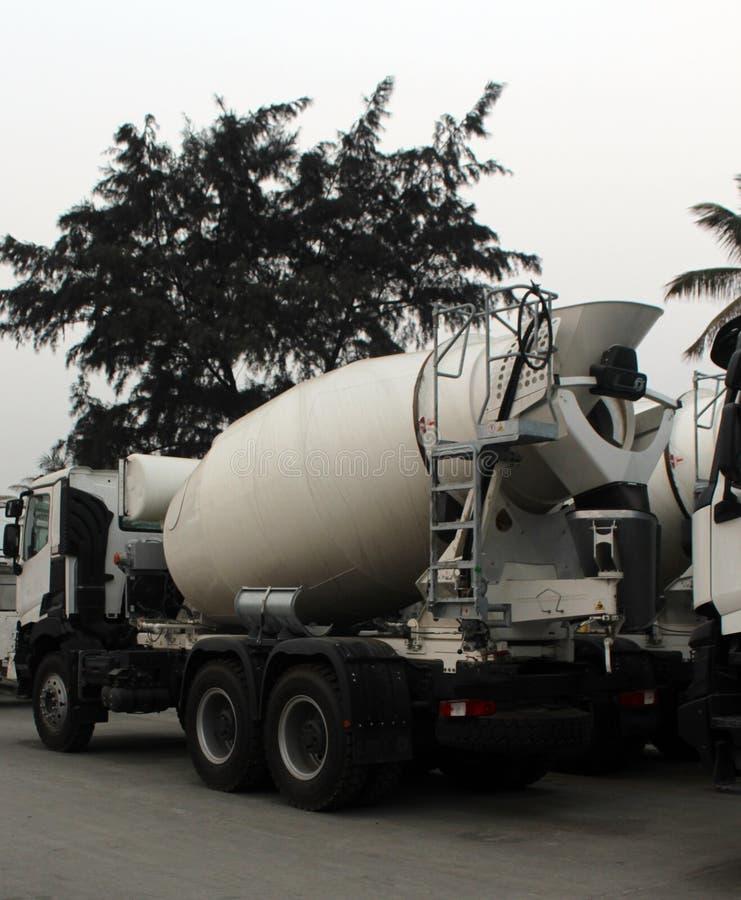 Concrete or cement mixer vehicle. Concrete mixer at at a road construction site apapa. Lagos nigeria stock images