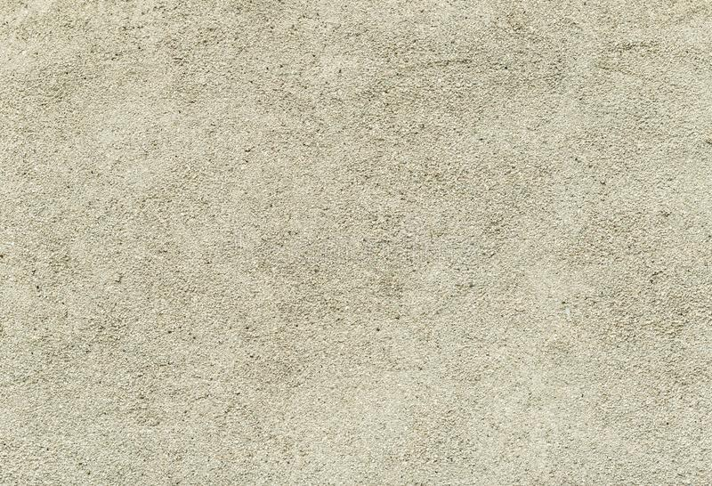 Concrete or cement wall with small stones, texture royalty free stock image