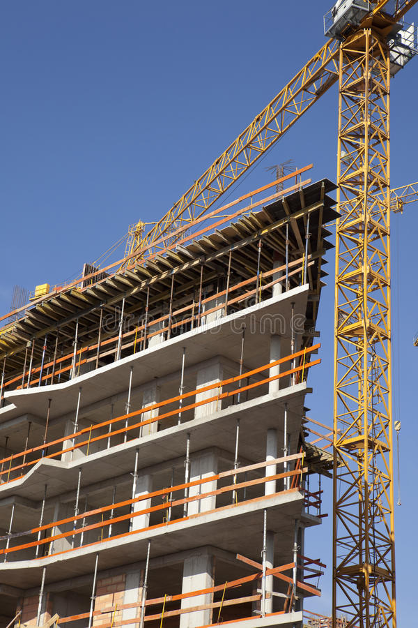 Download Concrete construction stock photo. Image of scaffolding - 23729910